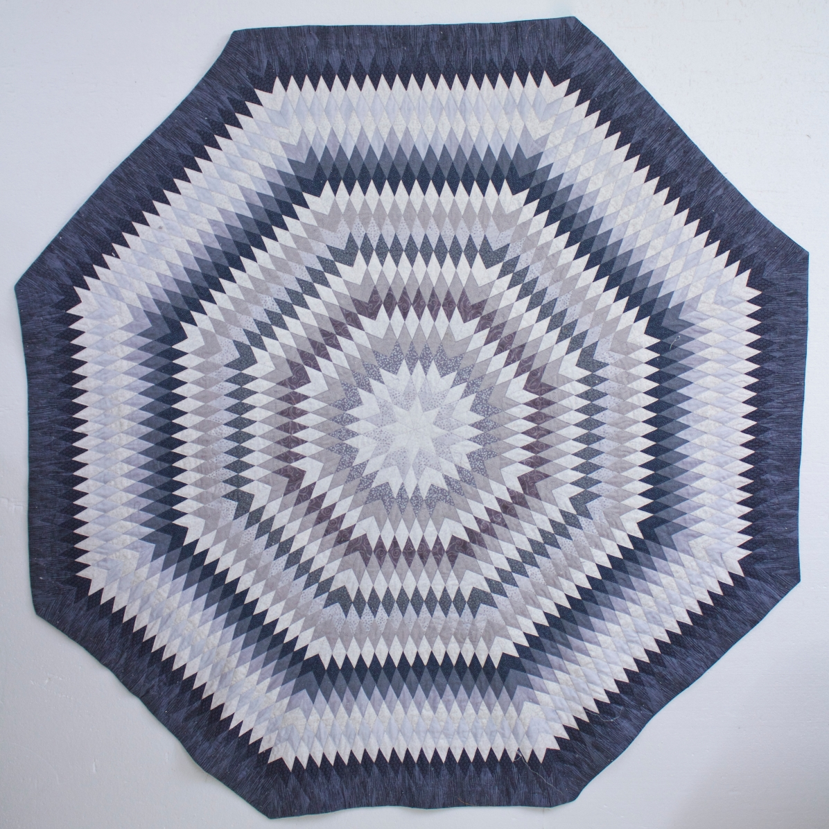 Blue Sun by Norma Slabbert, 2019. English Paper Piecing, Sunburst quilt design.